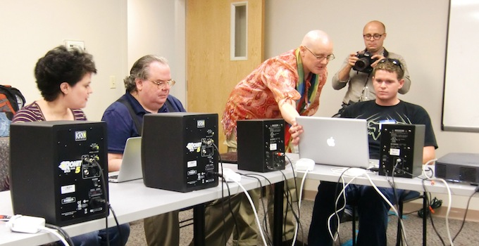 Photograph of people learning how to use the Adaptive Use Musical Instrument (AUMI) at Independence, Inc., Lawrence, in September 2012.